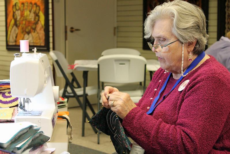 Susan Saarem sews a labyrinth