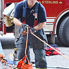 "Fitchburg fire fighter PJ Roy works during the  Technical Rescue Drill that was conducted with local fire departments on Thursday afternoon. A car accident was simulated, rolled down an embankment where ""victims"" were to be rescued. Fitchburg, Holden, Leominster, Lunenburg, and Sterling fire departments participated. SENTINEL & ENTERPRISE / Ashley Green"