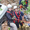 """Leominster fire fighters Brian LeBlanc, Paul Apolonio, and Jimmy Cameron work during the  Technical Rescue Drill that was conducted with local fire departments on Thursday afternoon. A car accident was simulated, rolled down an embankment where """"victims"""" were to be rescued. Fitchburg, Holden, Leominster, Lunenburg, and Sterling fire departments participated. SENTINEL & ENTERPRISE / Ashley Green"""