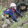 """Leominster fire fighter Steven Provencher works during the  Technical Rescue Drill that was conducted with local fire departments on Thursday afternoon. A car accident was simulated, rolled down an embankment where """"victims"""" were to be rescued. Fitchburg, Holden, Leominster, Lunenburg, and Sterling fire departments participated. SENTINEL & ENTERPRISE / Ashley Green"""