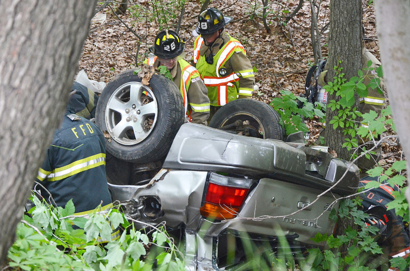 "A Technical Rescue Drill was conducted with local fire departments on Thursday afternoon. A car accident was simulated, rolled down an embankment where ""victims"" were to be rescued. Fitchburg, Holden, Leominster, Lunenburg, and Sterling fire departments participated. SENTINEL & ENTERPRISE / Ashley Green"
