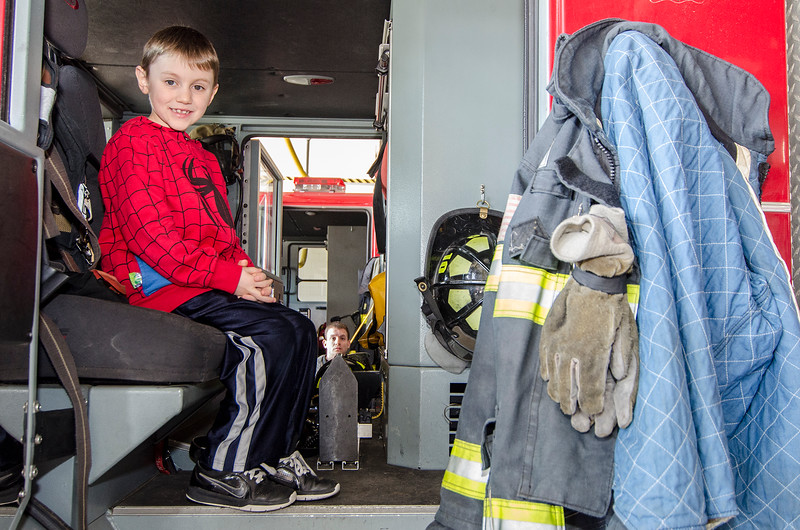 Deion Mejia, 8, checks out one of the fire trucks during the Child Safety Day at the Fitchburg Fire Department on Saturday afternoon. SENTINEL & ENTERPRISE / Ashley Green