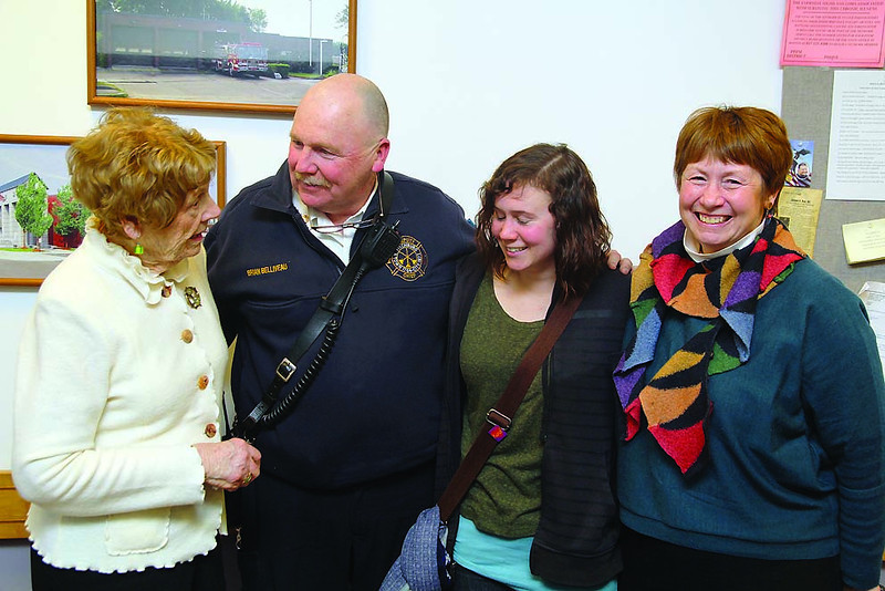 Fitchburg Fire Deputy Chief Brian Belliveau was working his last shift on Monday when he got thrown a retirement party at the Fire Station after spending more than 30 years on the job. Standing with Belliveau from left is his mom Jean Belliveau, his daughter Carly Belliveau and his sister Judy Belliveau. SENTINEL & ENTERPRISE/JOHN LOVE