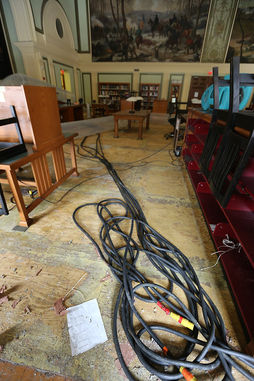 . Aftermath of flooding at Pollard Memorial Library, caused by burst pipes above the Reference Room, shown here. Flooring has been removed and room is still being dried out. (SUN/Julia Malakie)