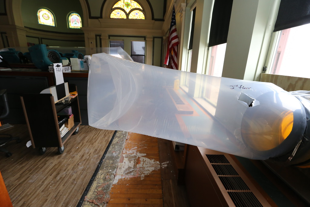 . Aftermath of flooding at Pollard Memorial Library, caused by burst pipes above the Reference Room. Flooring has been removed and some rooms are still being dried out. (SUN/Julia Malakie)