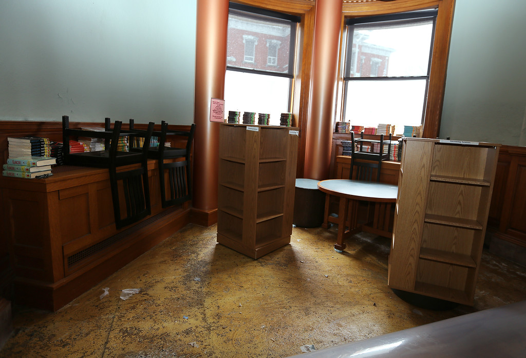 . Aftermath of flooding at Pollard Memorial Library, caused by burst pipes above the Reference Room. Flooring has been removed and some rooms are still being dried out. Ground floor room with floor removed. (SUN/Julia Malakie)