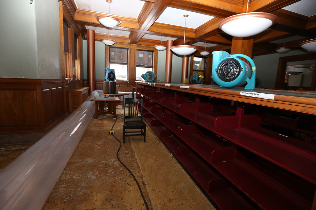 . Aftermath of flooding at Pollard Memorial Library, caused by burst pipes above the Reference Room. Flooring has been removed and some rooms are still being dried out. Emptied bookshelved in ground floor room. (SUN/Julia Malakie)