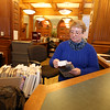 Aftermath of flooding at Pollard Memorial Library, caused by burst pipes above the Reference Room. In the closed library, library page Maria Kelly does normal work, preparing inter-library transer requests. (SUN/Julia Malakie)