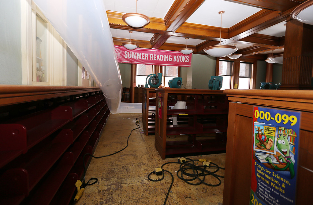 . Aftermath of flooding at Pollard Memorial Library, caused by burst pipes above the Reference Room. Flooring has been removed and some rooms are still being dried out. Empied bookshelves and air being pumped in through ground floor room. (SUN/Julia Malakie)