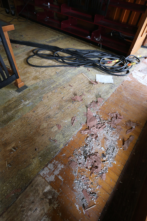 . Aftermath of flooding at Pollard Memorial Library, caused by burst pipes above the Reference Room, shown here. Wood flooring has been removed and some rooms are still being dried out. (This layer of wood flooring was underneath the good layer.(SUN/Julia Malakie)
