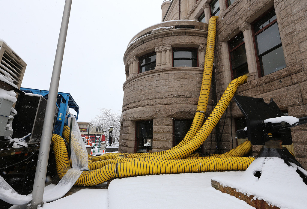 . Air is pumped into Pollard Memorial Library, to dry out areas affected by floooding caused by burst pipes above the Reference Room. (SUN/Julia Malakie)