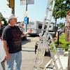The fire/police box on the common in Leominster is getting a facelift by Joe Mello who was hired by the police department to make the old call box look like new. Mayor Dean Mazzarella, in white shirt, stop by on Tuesday to talk to Mello about the job. SENTINEL & ENTERPRISE/JOHN LOVE