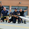From left is Leominster firefighters Scott Laprade, Shawn Phillips, Johnny Campagna, Jimmy Cameron and Vinny Alia as they help test the hoses on Tuesday morning in front of the Church Street station. SENTINEL & ENTERPRISE/JOHN LOVE