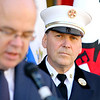 Leominster's Fire Chief Robert Sideleau listens to US Representative Jim McGovern as he talk about the grant that FEMA was giving to the fire station for a new ladder truck that will be here in a year. SENTINEL & ENTERPRISE/JOHN LOVE