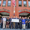 Members of the Leominster Fire Department, councilors Mayor Dean Mazzarella and US State Representative Jim McGovern gathered at the Fire Station to get a check from FEMA for a new ladder truck that will be here in a year. SENTINEL & ENTERPRISE/JOHN LOVE
