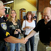 Leominster Police Sgt George Brewer shakes hands with  John La Stella during his visit to the Leominster Fire Department to thank them for saving his life on April 30th of this year. Just behind them is John's daughter Joy La Stalla and his sister-in-law Jackie LaStalla. SENTINEL & ENTERPRISE/JOHN LOVE