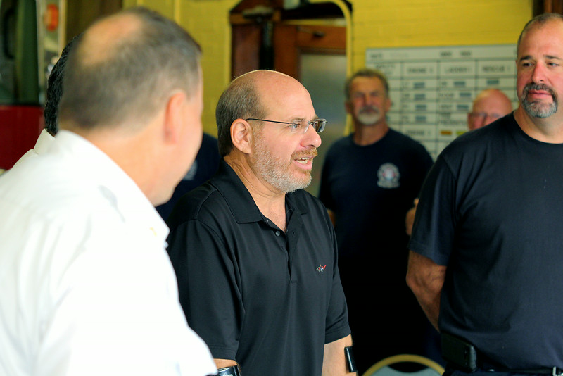 Members of the Leominster Fire Department along with MedStar and Mayor Dean Mazzarella listen to John La Stella during his visit to the Leominster Fire Department to thank them for saving his life on April 30th of this year. SENTINEL & ENTERPRISE/JOHN LOVE