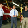 Leominster Mayor Dean Mazzarella, center, talks about John La Stella during his visit to the Leominster Fire Department to thank them for saving his life on April 30th of this year. On the left is Fire Chief Robert Sideleau. SENTINEL & ENTERPRISE/JOHN LOVE