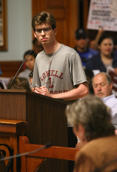 Lowell City Council listens to public comment ahead of the vote on the location for the new Lowell High School. 2015 Lowell High grad Jack Breen is challenged by councilor Rita Mercier to explain who he meant when he said a councilor had a conflict of interest. (SUN/Julia Malakie)