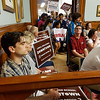 Lowell City Council listens to public comment ahead of the vote on the location for the new Lowell High School. Andrew Provencher of Lowell, left, supporter of the downtown location.(SUN/Julia Malakie)