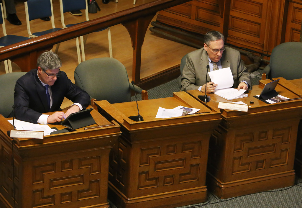 . At Lowell City Council, Rita Mercier sat in the seat of absent Dave Conway, instead of her usual seat in alphabetical order, between John Leahy, left, and Jim Milinazzo, right. (SUN/Julia Malakie)