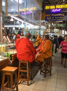 Thailand monks having tea at one of the gold shops in Scott market