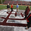 New artificial turf field at Cawley Stadium. From left, city councilor Bill Samaras, city manager Eileen Donoghue, city councilor Dan Rourke, assistant city manager and director of planning & developmnet Diane Tradd, and Yovani Baez-Rose, design planner who was project manager for the new turf. (SUN/Julia Malakie)