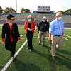 New artificial turf field at Cawley Stadium. From left, Yovani Baez-Rose, design planner who was project manager for the new turf, city manager Eileen Donoghue, and city councilors Bill Samaras and Dan Rourke. (SUN/Julia Malakie)