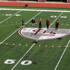 New artificial turf field at Cawley Stadium. From left, assistant city manager Kara Keefe-Mullin, city councilor Bill Samaras, city manager Eileen Donoghue, assistant city manager and director of planning & developmnet Diane Tradd, and Yovani Baez-Rose, design planner who was project manager for the new turf. (SUN/Julia Malakie)