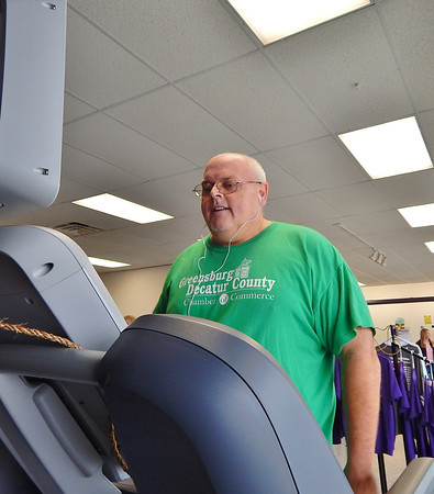 Jeff Emsweller walks the treadmill during the Big Brothers Big Sisters walk-a-thon fundraiser at Anytime Fitness.