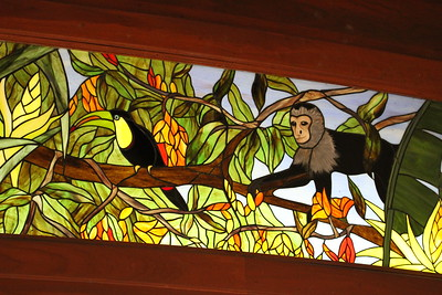 Stained glass of rainforest scenes are a vital part of the décor.