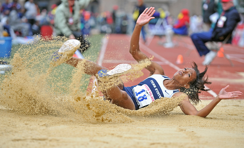 PHILADELPHIA - APRIL 27: Tanaya Lloyd from Penn State lands in t the sand after a jump in the College ladies tripple jump championship at the Penn Relays April 27, 2012 in Philadelphia.