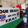 Department mechanic Kevin Davis and Lt. Richard Liberatore prepare the fire department's float for the 4th of July parade. The float will carry a steel beam that was part of the North Tower of the World Trade Center. SENTINEL & ENTERPRISE / Ashley Green