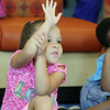 Aiyana Williamson, 5, raises her hand to ask Actress Karyn Parsons a question when she visited the Leominster/Fitchburg Boy's & Girls Club on Tuesday morning. SENTINEL & ENTERPRISE/JOHN LOVE