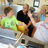From left is Jalen Leider, 13, of Fitchburg and Logan McGarry, 12, of Gardner as they explain the ideas they have for an experiment in space with former NASA astronaut Don Thomas and Michelle Lucas the President and founder of Higher Orbits. The two of the brought that program to the Leomister/Fitchburg Boys and Girls Club for three days this week. SENTINEL & ENTERPRISE/JOHN LOVE