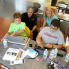 From left is Jacob Tocci, 12, from Leominster Jalen Leider, 13, of Fitchburg, Logan McGarry, 12, of Gardner and Jeff Tocci, 13, of Leominster as they explain the ideas they have for an experiment in space with former NASA astronaut Don Thomas and Michelle Lucas the President and founder of Higher Orbits. The two of the brought that program to the Leomister/Fitchburg Boys and Girls Club for three days this week. SENTINEL & ENTERPRISE/JOHN LOVE