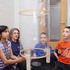 John and his sister Anna Clemente giving a donation to the Boys & Girls Club of Fitchburg and Leominster on Friday afternoon. During their visit to the club to annonce the donation, the children demonstrated their wind tunnel they used in a recent science festival. Trying out the tunnel is Joanelys Escuedero, 9, of Fitchburg. Watching is program instructor Luci Arel, and twins Owen & Camron Peters, 8, of Fitchburg.  SENTINEL & ENTERPRISE/JOHN LOVE