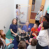 John and his sister Anna Clemente giving a donation to the Boys & Girls Club of Fitchburg and Leominster on Friday afternoon. During their visit to the club to annonce the donation, the children demonstrated their wind tunnel they used in a recent science festival. SENTINEL & ENTERPRISE/JOHN LOVE