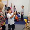 John and his sister Anna Clemente giving a donation to the Boys & Girls Club of Fitchburg and Leominster on Friday afternoon. During their visit to the club to annonce the donation, the children demonstrated their wind tunnel they used in a recent science festival. Explaining his creation he built to use in the tunnel to Anna and John is Oscar Perez, 8, of Fitchburg.  SENTINEL & ENTERPRISE/JOHN LOVE
