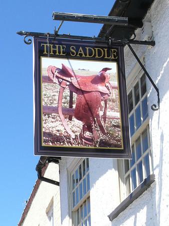 Pub Sign - The Saddle, High Street, Kimbolton 110626