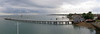 The pier isn't curved ....thats just an effect of stitching together several photos.