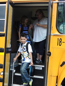 Hopping off the bus at Schoolcraft Elementary School in Waterford on Sept. 8, 2015.