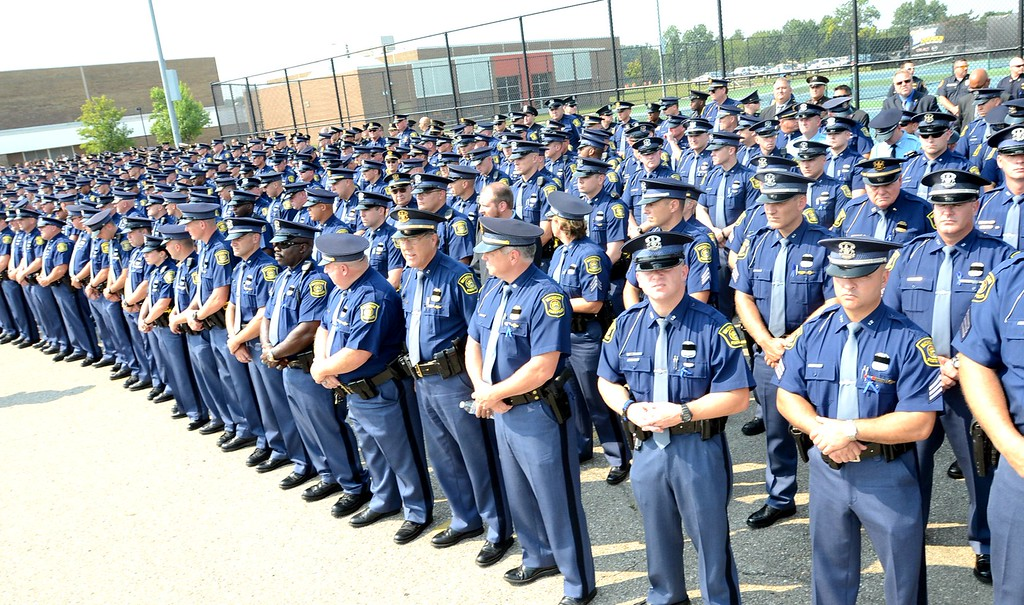 . A sea of Michigan State trooper assemble at Fenton High School for the funeral for Michigan State trooper Chad Wolf, 38 of Fenton, a motorcycle trooper was hit and dragged northbound on  I-75 in Independence Township Friday, later dying from his injuries.  Tuesday, September 1, 2015.  Tim Thompson-The Oakland Press