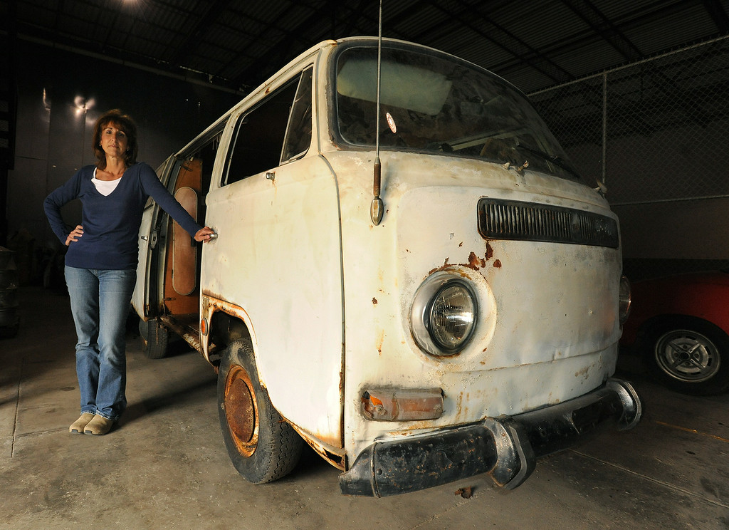 . Karen Laszlo stands next to the VW van once owned by Jack Kevorkian.  Laszlo is an assistant to Jack Finn, a VW parts expert, who bought the van from Kevorkian prior to his incarceration.  Finn has put the van for sale on ebay.  Photo taken on Friday, April 23, 2010, in Auburn Hills, Mich.  (The Oakland Press/Jose Juarez)