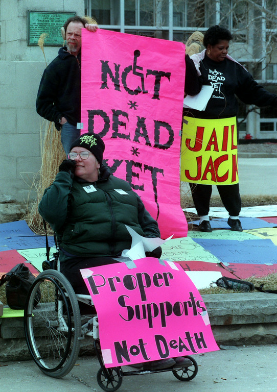 ". Members of ""Not Dead Yet\"" protest outside of Oakland County Circuit Court.  Inside,  Dr. Jack Kevorkian is being tried on murder charges for the dead Thomas Youk  of Waterford."