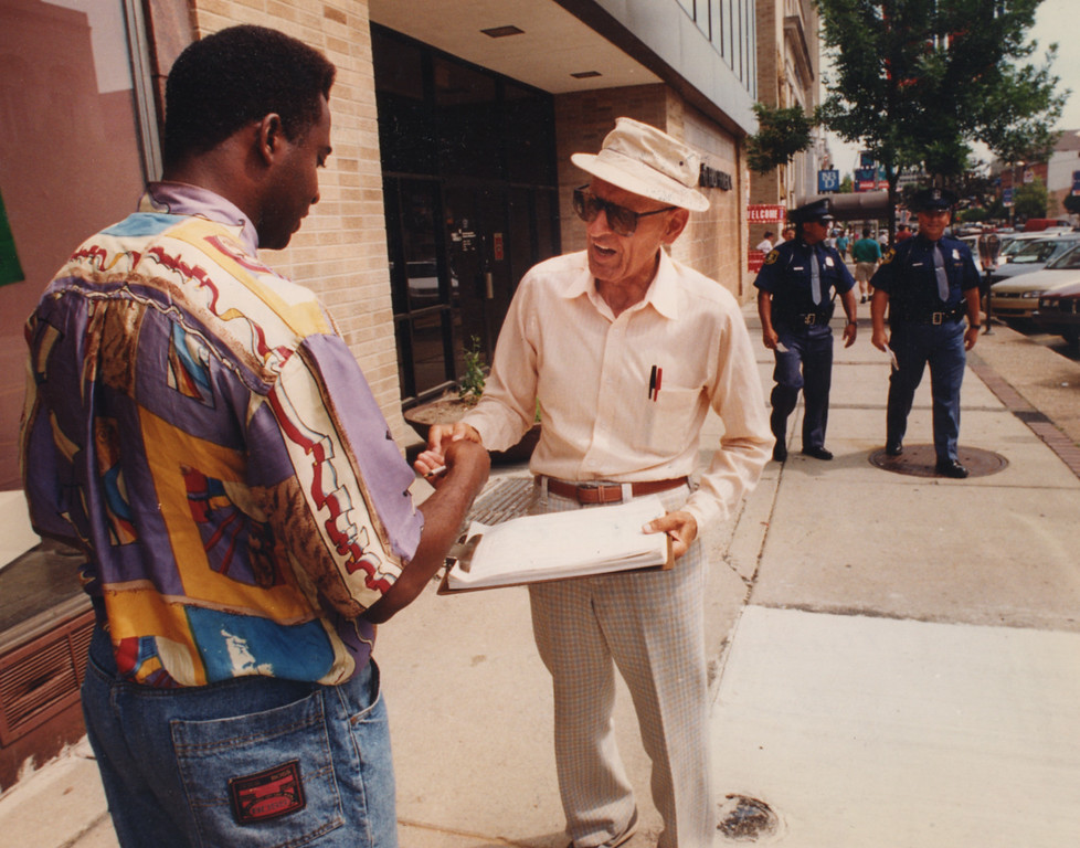 . 6/22/1994- Dr. Kevorkian gets people to sign his petition along Saginaw St. in Pontiac regarding a ballot issue.