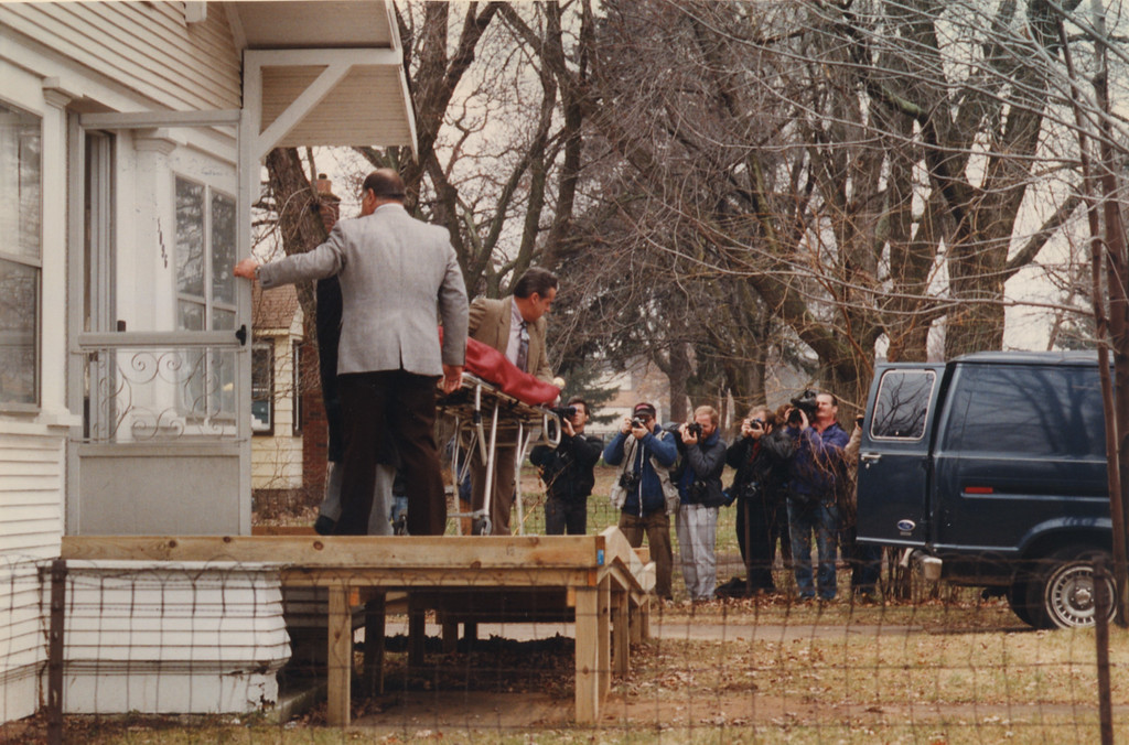 . 12/15/1992- Oakland County officials bring the body of one of two female patients of Dr. Kevorkian past a group of TV and News Reporters in Auburn Hills.