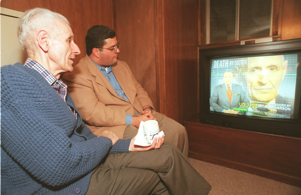 . Dr. Jack Kevorkian and his attorney David Gorosh watch the airing of the newsmagazine, \'60 Minutes\' Sunday night, which aired a video tape of Kevorkian performing  euthanasia to a  Waterford man  , Thomas Youk, 52 , back in September of this year. Kevorkian gave the video tape to CBS ,60 Minutes, in order to press the legal issue of euthanaisa in Michigan.