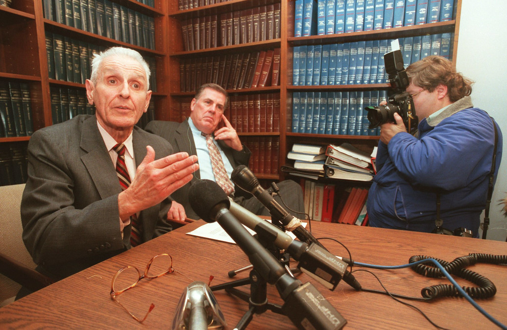 . Dr. Jack Kevorkian, left, Neil Nicol, right, medical technician and Dr. George Reading (not shown) held a press conference odering a ban on assisted suicide.