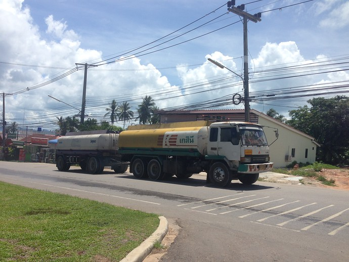 heavy duty lorries passing Through Klong Muang